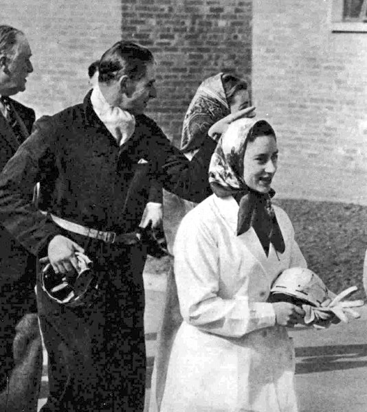 Carrying a safety helmet and wearing white overalls : Princess Margaret returning after descending the pit at Calverton.