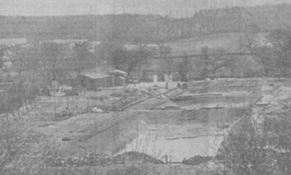 1939: A view of the Trent Board's Hatchery. In the foreground are the rearing and stock ponds, and in the background the fry ponds, the hatchery (long building to the left) and offices.